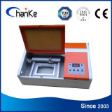 Mini macchina del Engraver del laser del tavolo del CO2 per l'acrilico del timbro di gomma