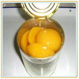 Sélection de qualité de pêche en boîte jaune en sirop