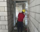 Bomba concreta/parede da construção que emplastra a máquina