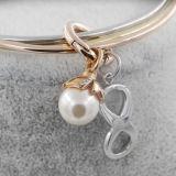 Neue Entwurfs-Form, die Armband-Schmucksachen mit Perle u. endlosem Charme stapelt