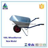 A construção galvanizada carreg o carrinho de mão de roda da areia e da água