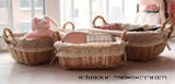 con la cesta de mimbre del almacenaje lindo oblongo del cordón