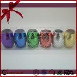 Oeuf s'enroulant décoratif coloré de bande