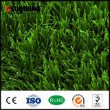 Verde del césped que pone el césped artificial para el campo de fútbol