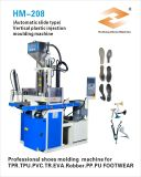 Machine de moulage injection en plastique verticale