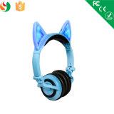 Écouteurs sans fil rougeoyants de Bluetooth de couleur d'éclairage LED pour des gosses