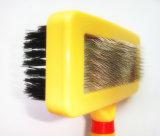 El perro plástico de la maneta que prepara a Bush, acaricia un cepillo más parejo