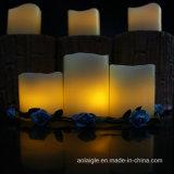 Velas amarillas de la luz del té de la cera de parafina de la decoración de la noche que oscilan