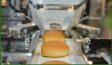 Equipamento envolvido de papel automático da embalagem do bolo da manteiga do bolo de Madeira do bolo