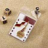 紙カードの裏付けが付いているカスタム金のバッジの紋章