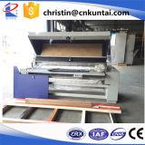 Tissu de qualité examinant la machine
