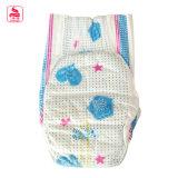 La venta caliente imprimió los pañales respirables disponibles del bebé con precio bajo de la cinta mágica