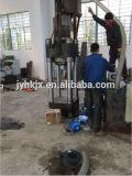 O metal poderoso hidráulico lasca a imprensa de ladrilhagem
