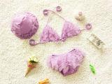 분홍색 어린 소녀의 형식 수영복