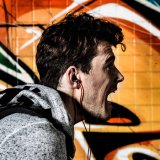 Móbil prendido 3.5mm de venda quente dos auriculares no fone de ouvido da orelha