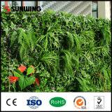 Il fiore artificiale verde esterno delle decorazioni domestiche pianta le reti fisse