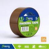 ラベルが付いている淡黄色の接着剤の包装テープ
