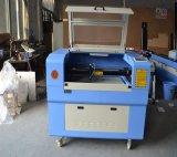 Machine de gravure en cuir de laser de découpage de PVC de forces de défense principale d'acrylique en plastique FM6090