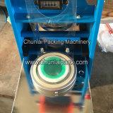 Máquina plástica manual del lacre de la taza