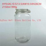 シールが付いている大きい円形のガラス容器の記憶のガラス瓶