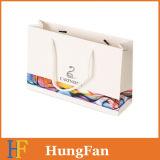 Bolso fresco impreso del regalo del diseño del papel revestido con la cuerda del algodón
