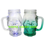 Le double a fait face aux chocs en verre de tasse de crâne, tasse en verre avec des traitements, lumières colorées en bas