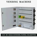 Máquina de Vending mecânica do preservativo e do cigarro no hotel