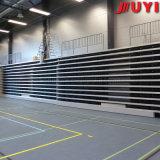 Jy-769 venden al por mayor la arena telescópica del asiento de la etapa de los blanqueadores retractables móviles resistentes al fuego de la gimnasia