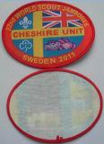 Emblema tecido da forma roupa oval