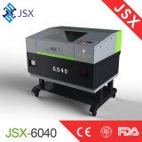Jsx6040ファブリック革切り分ける切断の専門の二酸化炭素レーザーのカッター