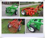 le tracteur 20-30HP a accroché la moissonneuse de pomme de terre simple de rangée