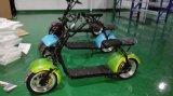 Vespa eléctrica de la movilidad del soporte verde de la fuente con la rueda grande