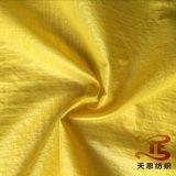 Tela elástica de nylon do tafetá da tela de matéria têxtil 100% de China com petróleo Cire para para baixo revestimentos e tela do vestuário