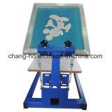 Uma máquina manual da impressora da tela de matéria têxtil da cor