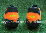 De lichtgele OpenluchtVoetbalschoenen van de Voetbal