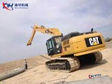 Землечерпалка 18m Caterpillr Cat336D2 длиной достигает заграждение