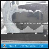 墓碑のための黒い花こう岩の天使の中心の黒の花こう岩の石の墓石か記念碑または墓石