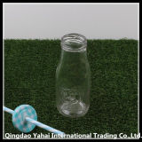 Botella de leche de cristal clara/tarro de cristal con la tapa y la paja
