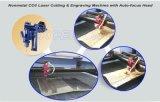 次のヘッドが付いている非金属二酸化炭素レーザーの彫版そして打抜き機