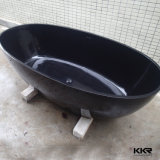Banheira ereta livre do preto redondo interno de pedra pequeno