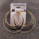 Six boucles d'oreille rondes de cercle plaquées par or d'émail de couleur de sucrerie grandes