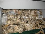 O bloco duro de madeira conduz o Shredder do eixo