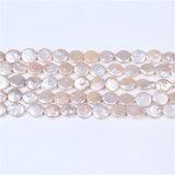 La moneda cultivó granos de agua dulce de la perla garantizó el 100% natural