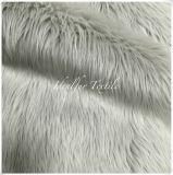 灰色の贅沢で長い山ののどの毛羽織りの毛皮ファブリック