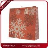 クリスマスカラー及びデザインのペーパーギフト袋、Chirstmasのペーパーギフト袋、ねじれのハンドルが付いているアートペーパー袋のホイルの紙袋