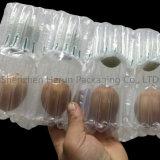 Handiness che impacca per l'uovo con il sacchetto della colonna dell'aria