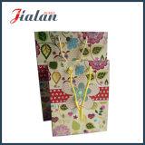 La coutume vend le sac estampé par logo de papier d'emballage d'emballage de cadeau d'achats