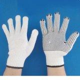 Промышленная деятельность хлопка поставила точки связанные перчатки при поставленный точки PVC
