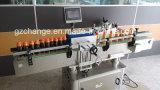 Las botellas de alta velocidad automáticas sacuden la etiqueta engomada de las escrituras de la etiqueta
