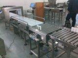 Metallbefund-Maschine und Waage zusammen